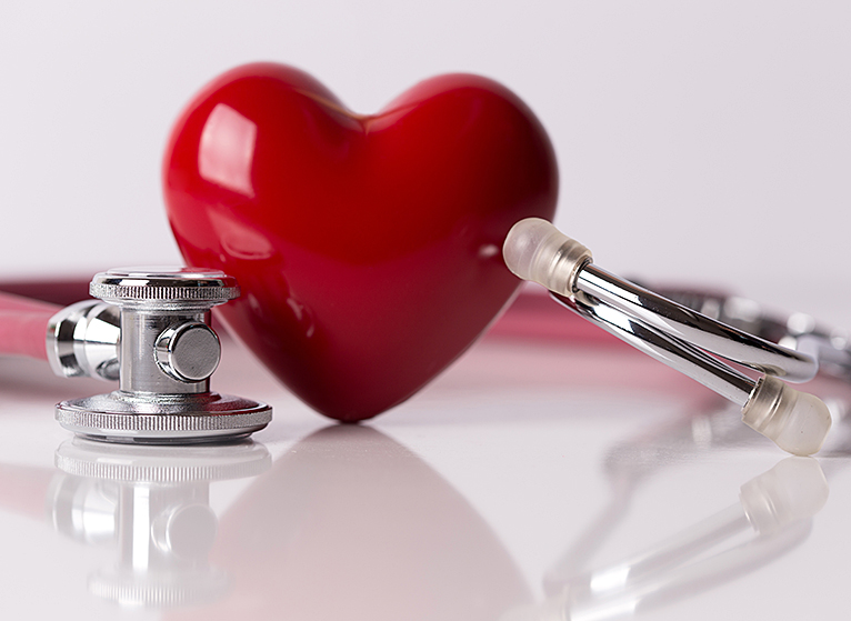 closeup of stethoscope and plastic red heart