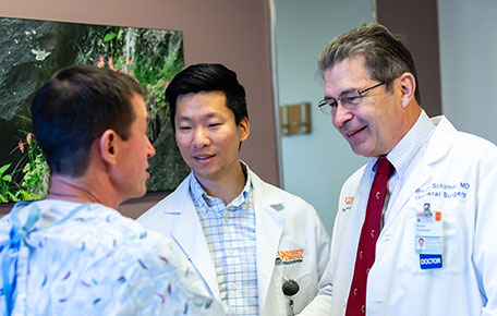 UVA Surgery faculty with Med student caring for a patient.