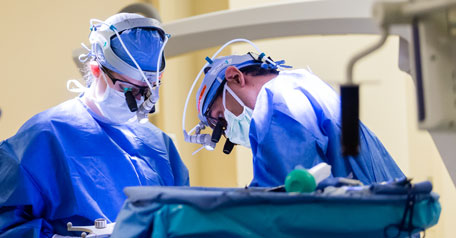 UVA transplant surgeons operating on a patient.