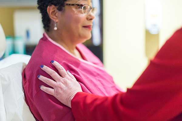 UVA Breast and Melanoma Surgery Division care provider comforts a patient