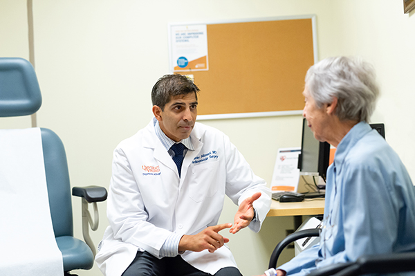 UVA Cardiac surgeon consulting with a patient before surgery.