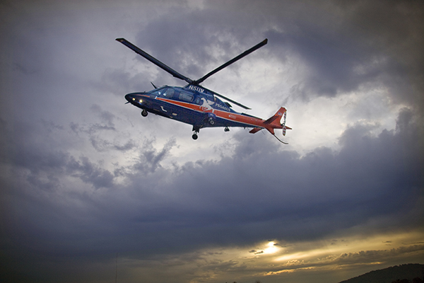 UVA Pegasus helicopter hovering against a sunset