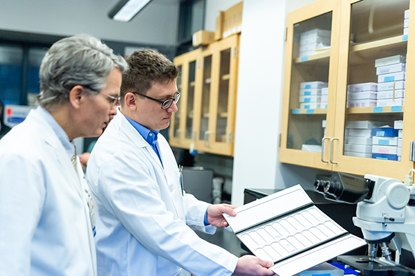 University of Virginia Doctors examine samples in their clinical laboratory.