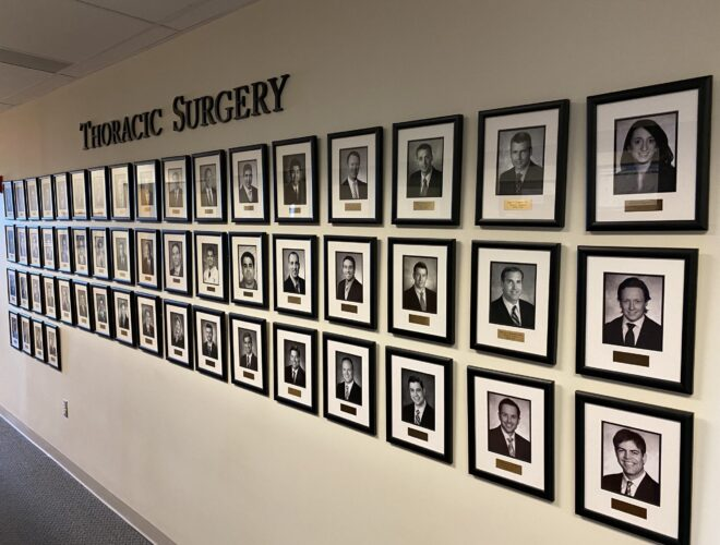 Wall of pictures of Thoracic Surgery Graduates
